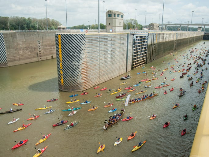 Paddlers leave the McAlpine Locks as they make their way to New Albany as part of the Mayor's Hike Bike & Paddle event at Waterfront Park. September 1, 2014