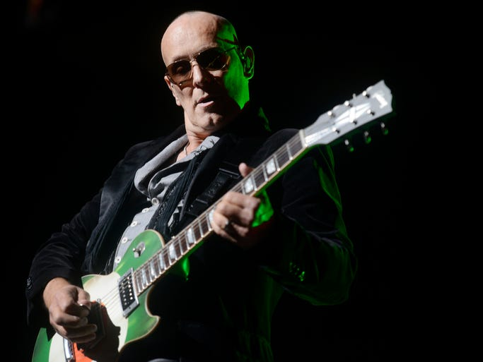 Guitarist Vivian Campbell of Def Leppard performs at Bridgestone Arena while on tour with KISS, during the KISS 40 Tour, on Wednesday July 16, 2014 in Nashville.