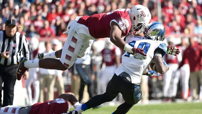 Nov 21, 2015; Philadelphia, PA, USA; Temple Owls defensive lineman Haason Reddick (58) dives to make a tackle on Memphis Tigers wide receiver Jae'lon Oglesby (19) during the first half at Lincoln Financial Field. Mandatory Credit: Derik Hamilton-USA TODAY Sports