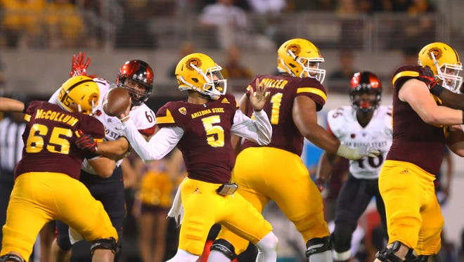Arizona State Sun Devils quarterback Manny Wilkins (5) throws a pass in the first half against the San Diego State Aztecs at Sun Devil Stadium.
