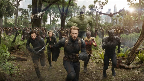 Captain America (Chris Evans, center) and Black Panther (Chadwick Boseman, right) lead their allies in the fight against invading villains in 'Avengers: Infinity War.'