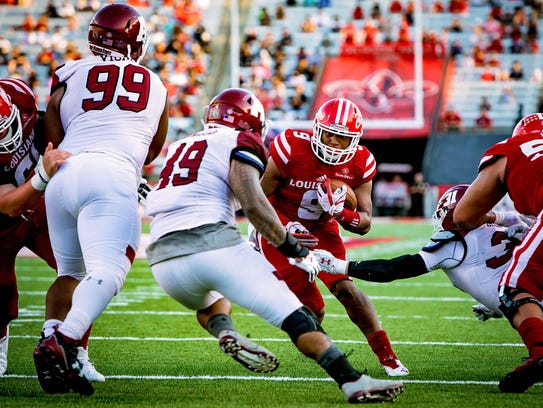 ULL RB Trey Ragas looks for an opening in the defense