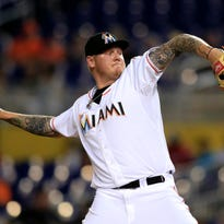 Marlins starting pitcher Mat Latos throws the ball in the first inning against the Giants at Marlins Park on June 30.