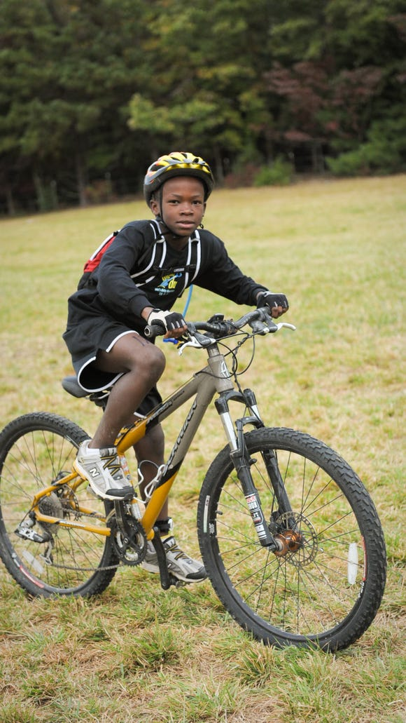 A participant competes in a past Dig the Du off-road triathlon near DuPont Forest.