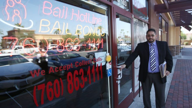 The city of Indio is considering putting a limit on the amount of bail bond services near the courthouse. In this photo, Eduardo Figueroa, manager for Bail Hotline Bonds is photographed at his service near the courthouse.