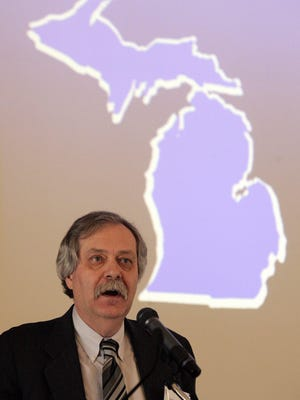 University of Michigan professor George Fulton , pictured here in 2006, presents an annual forecast on Michigan's economy. TONY DING/Special to the Free Press