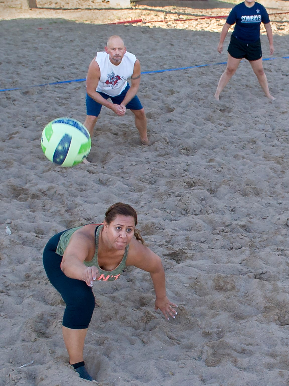 Eva Ortega gets a nice dig on the ball during a pickup sand volleyball game Sunday evening at the Meerscheidt Recreation Center.