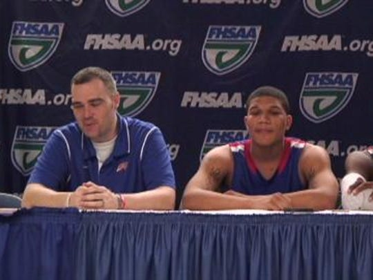 Brad Grant sits at a press conference at the 2013 FHSAA basketball state championships after leading the Pine Forest Eagles to the Class 6A state finals.