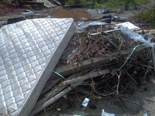 Trash, including a mattress, dumped illegally at the Leonardo State Marina in Middletown.