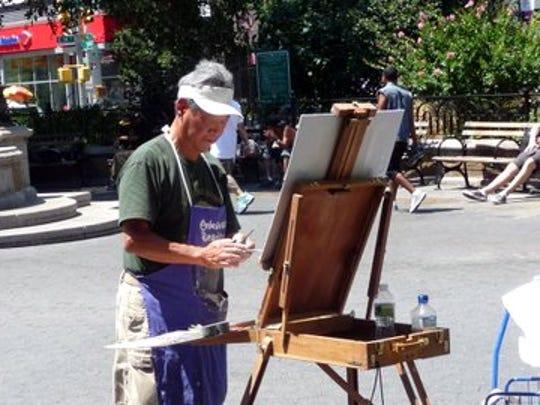 Artist Weimin Mo at work.