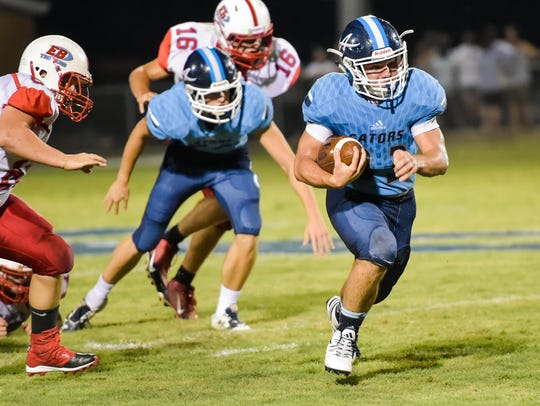 Leo Franques runs for a touchdown as the Ascension
