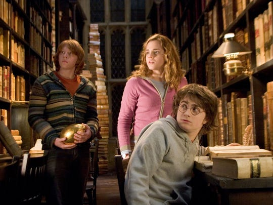 """RUPERT GRINT as Ron Weasley, EMMA WATSON as Hermione Granger and DANIEL RADCLIFFE as Harry Potter in """"Harry Potter and the Goblet of Fire."""""""