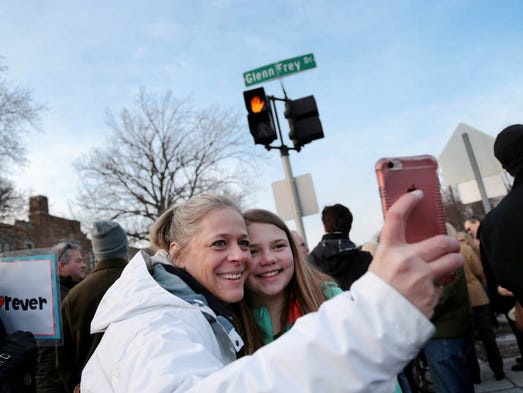 Rebecca Dostie, left, 42, of Royal Oak takes a selfie