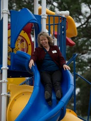 Impact 100 member, Mari Abbate, tries out the new playground