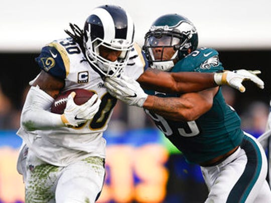 Los Angeles Rams running back Todd Gurley II, left, in action while Philadelphia Eagles linebacker Mychal Kendricks defends on Dec. 10.