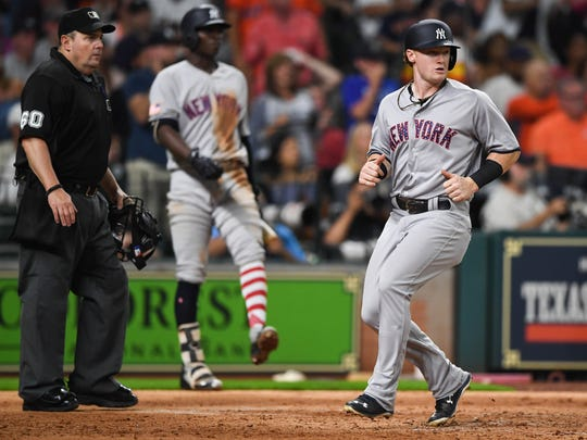 New York Yankees center fielder Clint Frazier (30) scores a run during the sixth inning of the game against the Houston Astros at Minute Maid Park on Saturday, July 1, 2017, his major league debut.