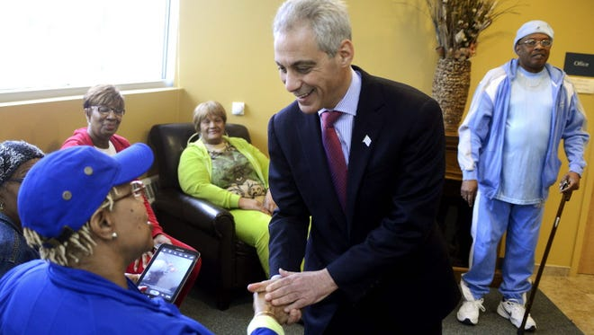 Chicago Mayor Rahm Emanuel visits with residents of Hancock House, a senior living complex in Chicago on Feb. 25, 2015, a day after failing to win a majority in the mayoral election.