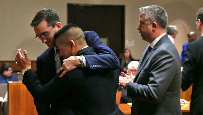 Charles Tan reacts with his defense team after charges were dismissed in his murder trial on Nov. 5, 2015.