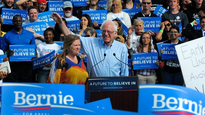 Democratic presidential candidate Sen. Bernie Sanders (I-Vt.) and his wife, Jane Sanders, greet supporters during a campaign event on March 10, 2016 in Kissimmee, Fla.