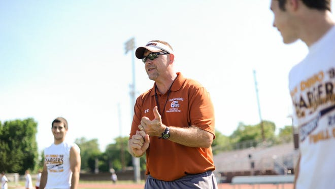Ted Evans resigned as Dumont's head football coach Wednesday, needing to free up time as he pursues a graduate degree.