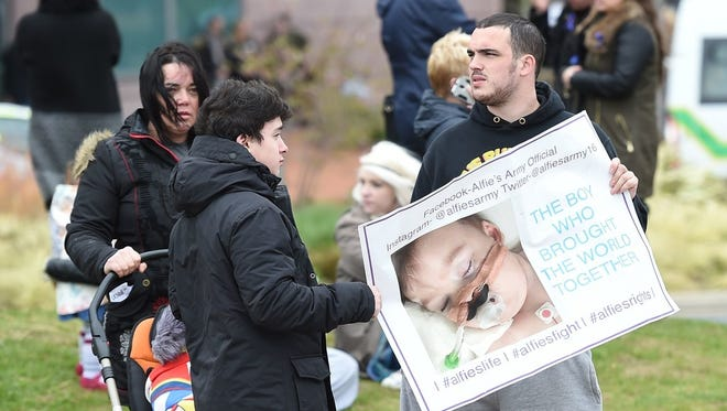 Alfie Evans' supporters react to the announcement that the European Court of Human rights refused to intervene in the case of the British toddler. Photo: April 23.