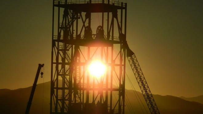 Nevada Copper and the City of Yerington hope not many more suns set--such as this setting sun seen through the headframe structure at Pumpkin Hollow--before legislation is passed and signed by President Barack Obama, conveying 10,400 acres around the mine site to the city and company for future development.
