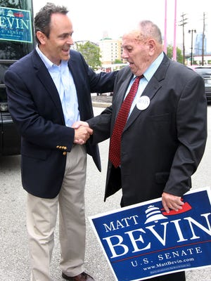 Matt Bevin (left), Republican candidate for U.S. Senate, greets supporter Bill Marksberry, of Fort Wright, after arriving at the Radisson, Covington, for the Republican Party of Kenton County's Spring Fling.