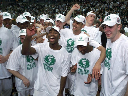 Mateen Cleaves, center, leads the festivities on the court as the Spartans celebrate MSU's NCAA regional final win over Iowa State.