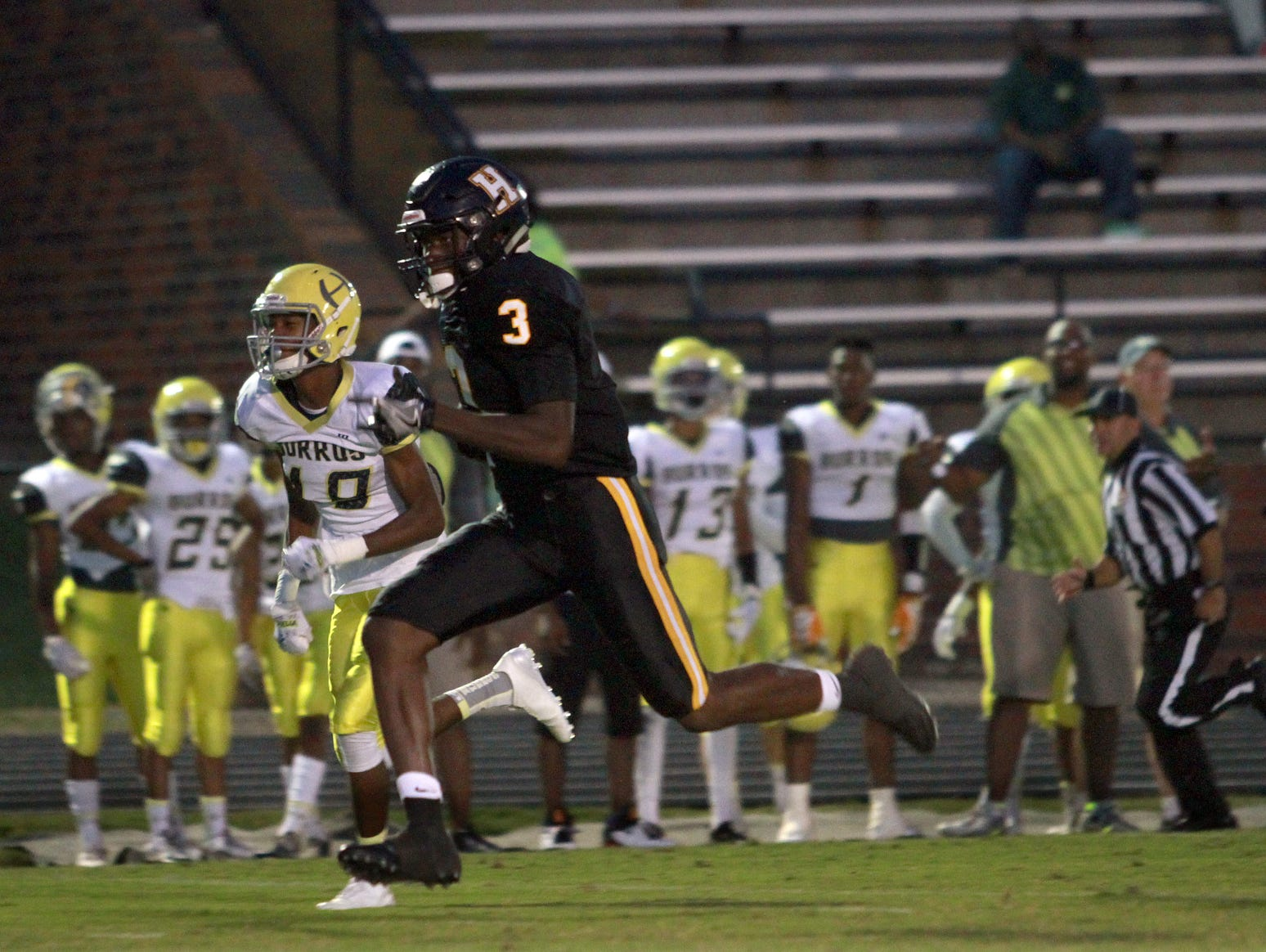 Hendersonville's Anthony Hughes rushes past Hillboro's Antwuan Gooner on his way to a touchdown in Hendersonville, TN on Fri. Sept. 16, 2016. Photo by Dave Cardaciotto