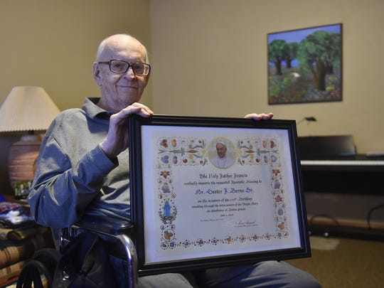 Lester Berns hold the commendation he received from Pope Francis on his 100th birthday.