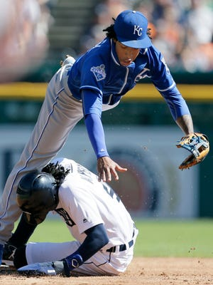 Royals second baseman Raul Mondesi tumbles over Tigers centerfielder Cameron Maybin after turning the ball to get a double play on Miguel Cabrera at first base during the first inning Sunday at Comerica Park.