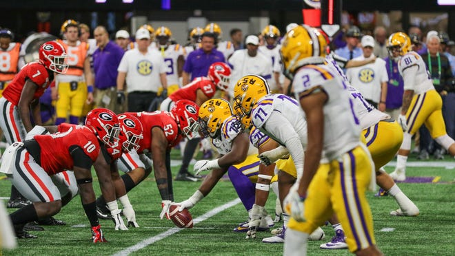 The LSU offense and Georgia defense get ready to snap the ball during the Southeastern Conference championship game game on Dec. 7 in Atlanta.
