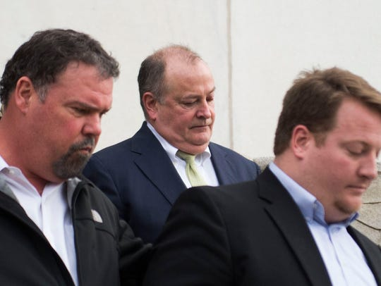 Former Pilot Flying J President Mark Hazelwood exits the federal courthouse in Chattanooga on Feb. 15. Prosecutors are asking he receive 14 years in prison and a $750,000 fine for his role in the truck-stop giant's fraud scheme.
