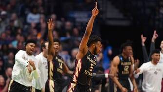 Florida State guard PJ Savoy  reacts to a play against Xavier during the second round of the 2018 NCAA tournament at Bridgestone Arena.