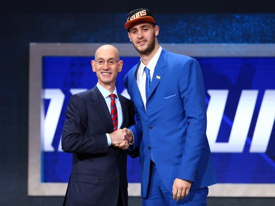 Jun 23, 2016; New York, NY, USA; Georgios Papagiannis greets NBA commissioner Adam Silver after being selected as the number thirteen overall pick to the Phoenix Suns in the first round of the 2016 NBA Draft at Barclays Center. Mandatory Credit: Jerry Lai-USA TODAY Sports ORG XMIT: USATSI-269318 ORIG FILE ID: 20160623_jel_sl8_130.jpg