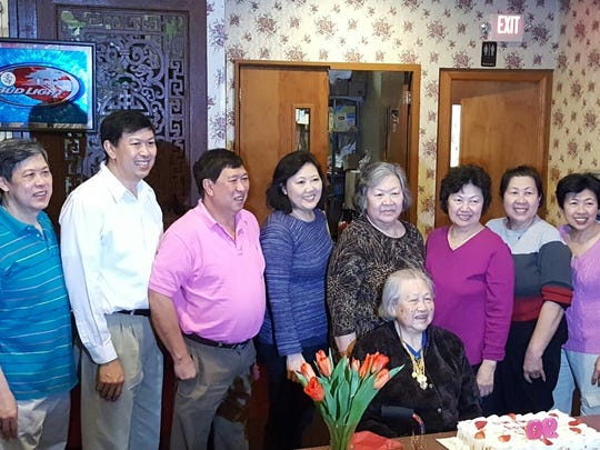 Christopher Siv, second from left, poses with his family at a birthday party. They are from left Konglan, Christopher, Chan, Lor, Mgoun Phok, Sinh, Kimheng and Tiffany. His mother, Vann, is seated.