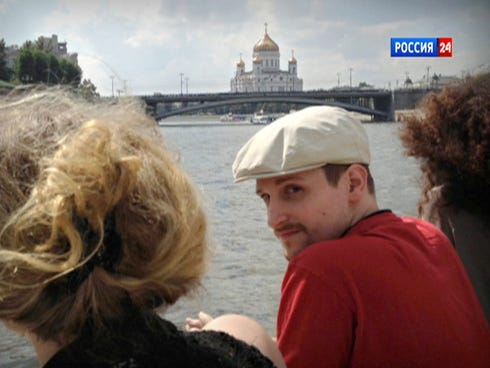In this video frame grab provided by LifeNews via Rossia 24 TV channel, Edward Snowden looks over his shoulder during a boat trip on the Moscow River.