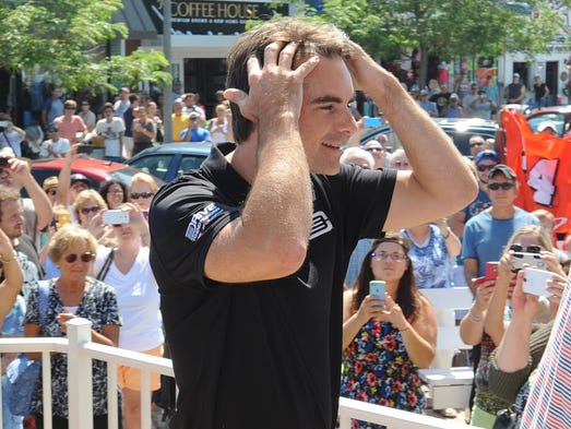 Nascar great Jeff Gordon seems overwhelmed at the reception he got when he arrived at the Rehoboth Bandstand Wednesday.