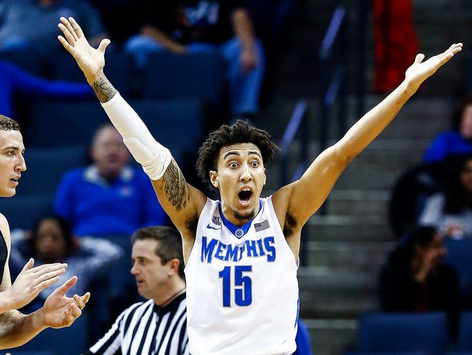 Memphis forward David Nickelberry (right) reacts after