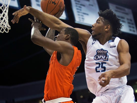 Old Dominion's Brandan Stith (25) defends against UTEP's Lee Moore during the first half Thursday, in Norfolk, Va.