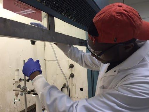 RIT student Nnamdi Akporji purifies a targeting agent.