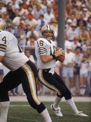 CANTON, OH - 1983:  Quarterback Ken Stabler #16 of the New Orleans Saints drops back to pass during the NFL Hall of Fame Game at Fawcett Stadium in Canton, Ohio in 1983.  (Photo by Jonathan Daniel/ Getty Images)