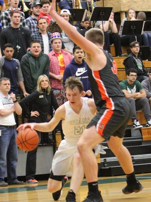 West Salem's Justin Scoggin (left) drives against Sprague's Teagan Quitoriano on Tuesday, Feb. 6, 2018.