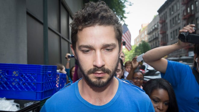 "Shia LaBeouf is followed by media after leaving Midtown Community Court following his arrest the previous day for yelling obscenities at the Broadway show ""Cabaret,"" Friday, June 27, 2014, in New York."