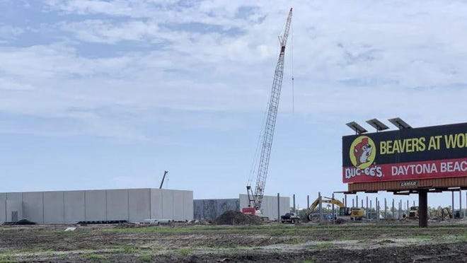"A ""Beavers at Work"" sign along Interstate 95 in Daytona Beach lets passing motorists know that construction is underway on a Buc-ee's gas station/travel convenience center on the northeast side of the I-95/LPGA Boulevard interchange on Tuesday, June 9, 2020. When it opens in the second quarter of 2021, it will have 120 fuel pumps and a 53,000-square-foot store that will employ 200 workers."