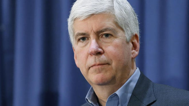 FILE - In this Feb. 26, 2016, file photo, Michigan Gov. Rick Snyder listens to a question after attending a Flint Water Interagency Coordinating Committee meeting in Flint, Mich. The abbreviated lame duck session that occurs every two years in the state Capitol has produced some of Snyder and Republican lawmakers' most significant laws. (AP Photo/Paul Sancya, File)