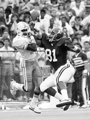 Tennessee defensive back Terry Brown (14) knocks the ball from the hands of Alabama receiver Thornton Chandler (81) during a game Oct. 19, 1985.