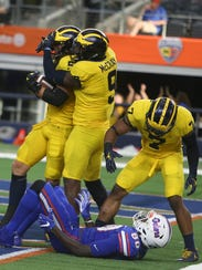 Michigan's Noah Furbush celebrates his fumble recovery
