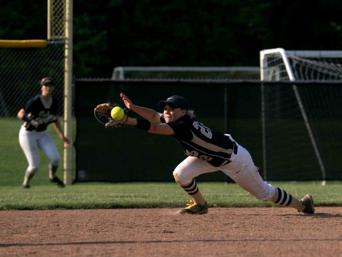 Lancaster's second baseman Ashlee Hawks dives for a