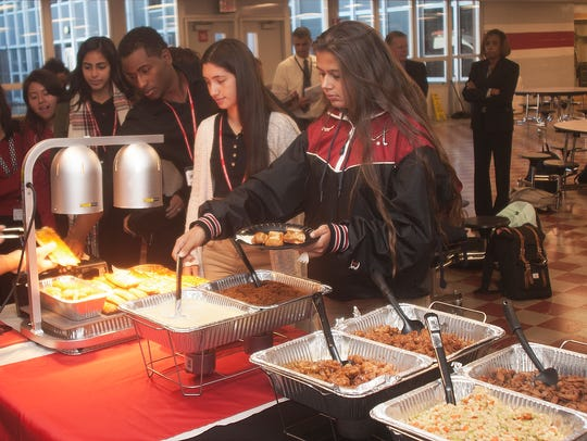 Vineland High School student, Alexis Pineda, right, serves herself the on a buffet line.